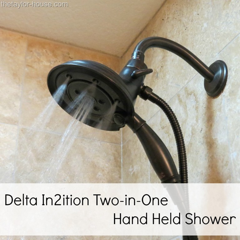 installing the delta in2ition showerhead was pretty simple first we had to remove the existing showerhead by simply unscrewing the old head with a pair of