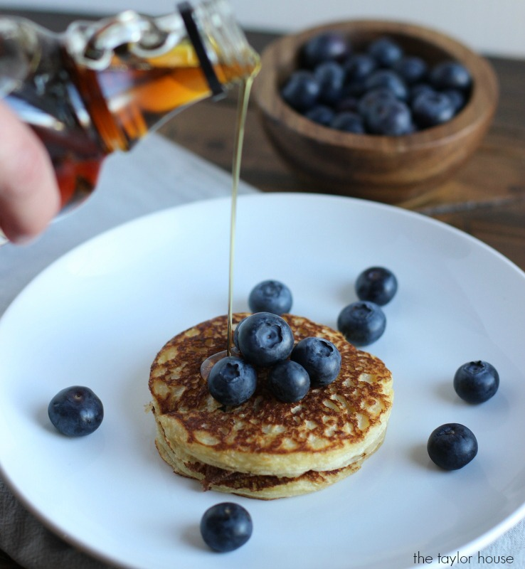 Delicious and Nutritious Blueberry Quinoa Pancakes with a glass of Chocolate milk is the PERFECT breakfast!